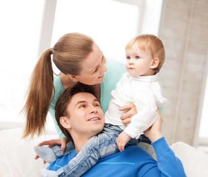 picture of happy parents playing with adorable baby