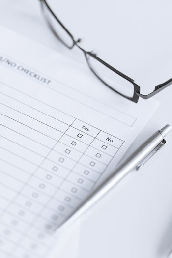 blank questionnaire or form with eyeglasses
