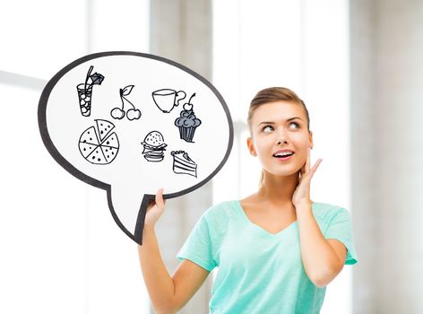 girl showing text bubble with junk food icons