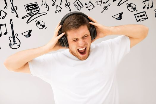 man with headphones listening loud music