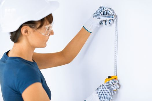architect measuring wall with flexible ruller