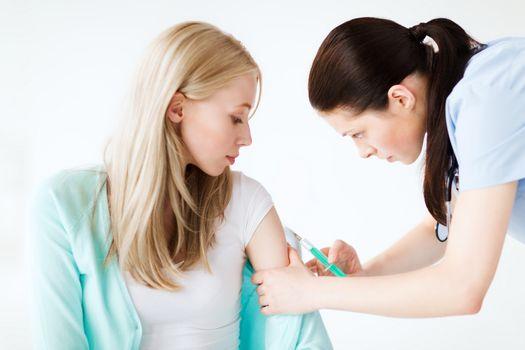 doctor doing vaccine to patient