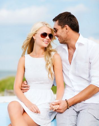 couple in shades at seaside