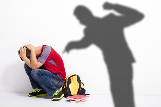 Man shadow attack   to terrified student with a fist
