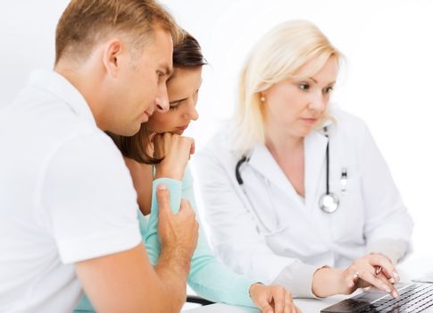 healthcare, medical and technology - doctor with patients in hospital