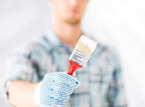 man hand with paintbrush