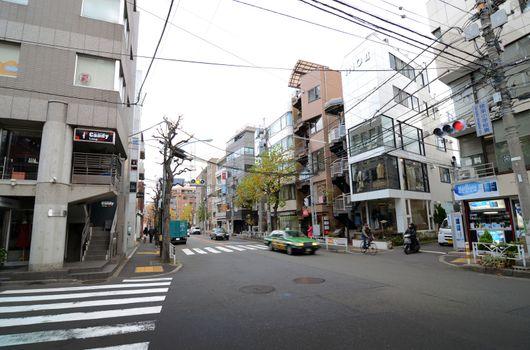 TOKYO - NOVEMBER 28, 2013: Traffic at the intersection of Daikanyama