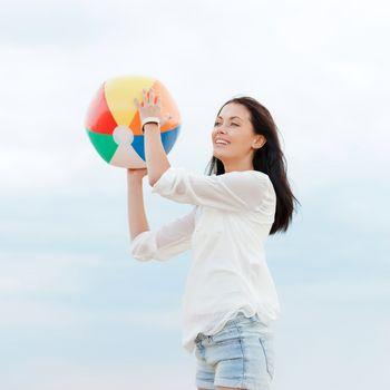 girl with ball on the beach