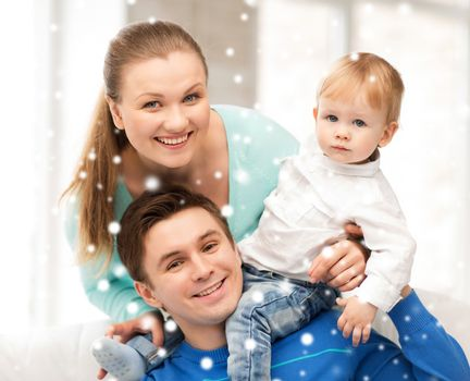 family, children, christmas, x-mas, love concept - happy parents playing with adorable baby