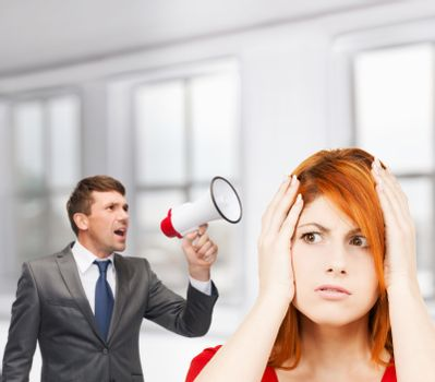 buisnessman with bullhorn and stressed woman