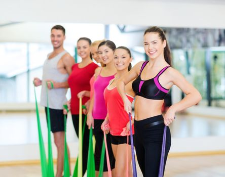 group of people working out with rubber bands