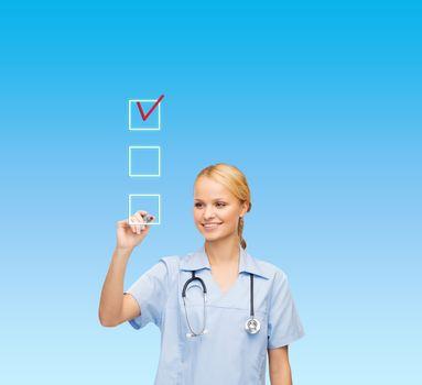 doctor or nurse drawing checkmark into checkbox