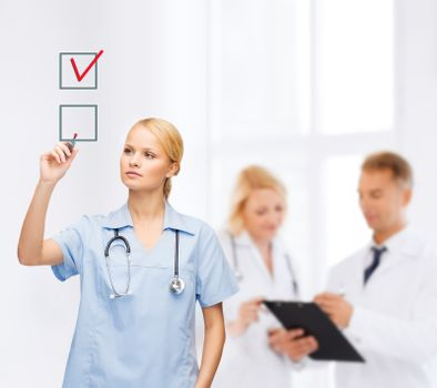 doctor or nurse drawning checkmark into checkbox