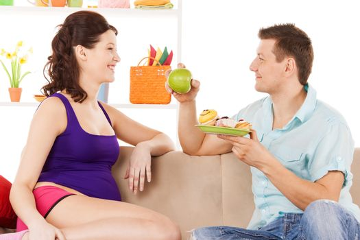 happy expecting parents at home