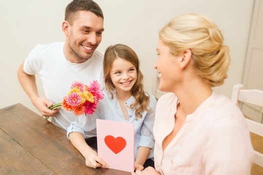 holidays, family, hapiness and people concept - happy family celebrating mothers day
