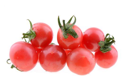Cherry tomato fruits on a white background