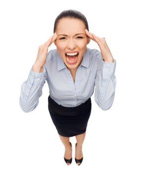 frightened businesswoman screaming