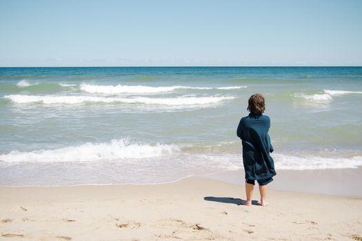 Boy standing on the beach