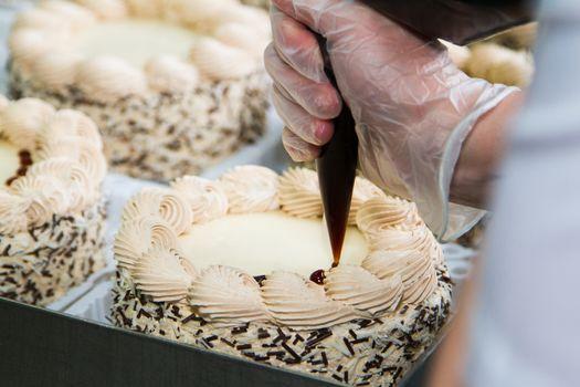 Chef piping cream - Stock Image