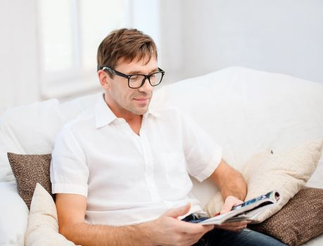 man with magazine at home