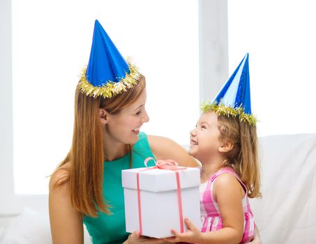 mother and daughter in blue hats with favor horns
