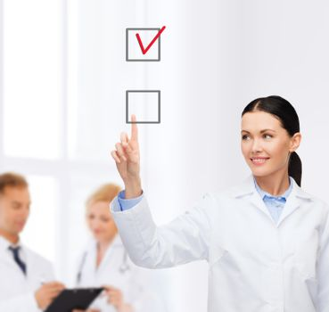 smiling female doctor pointing checkbox