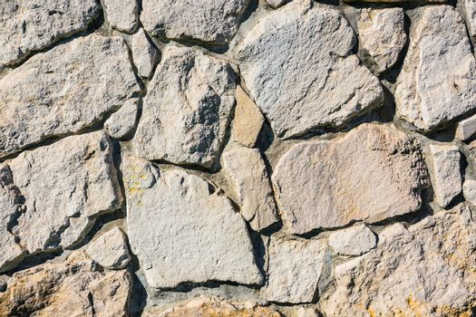 Old stone brick wall fragment as a background texture
