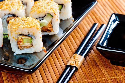Japanese rolls on a beautiful black crockery