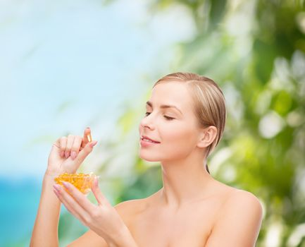 lovely woman with omega 3 vitamins