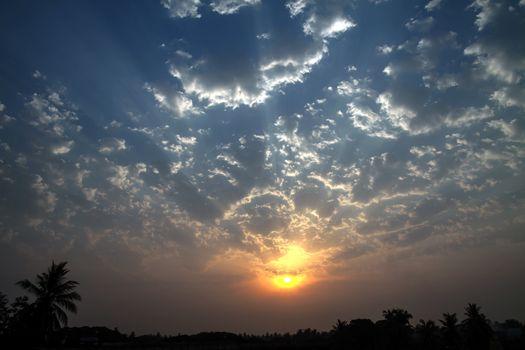 Dramatic Dawn Sun Skyscape Edge Lighted Cumulus Clouds