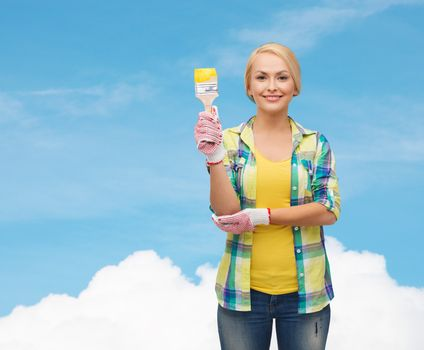 smiling woman with paintbrush