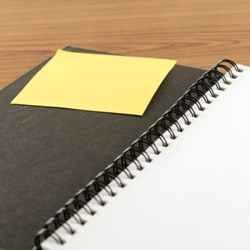 open notebook with post it