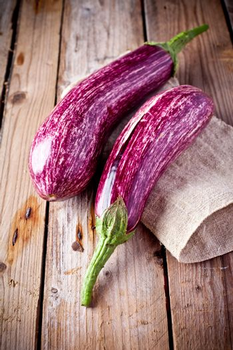 two fresh eggplants