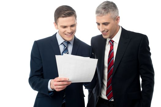 Confident businessmen reviewing records