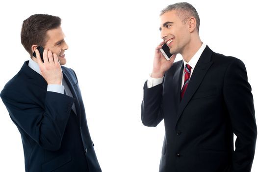 Handsome businessmen with cell phones