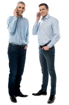 Young executives talking through mobile phone