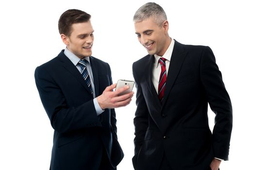Businesspersons looking at the mobile phone