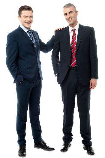 Two business partners posing together