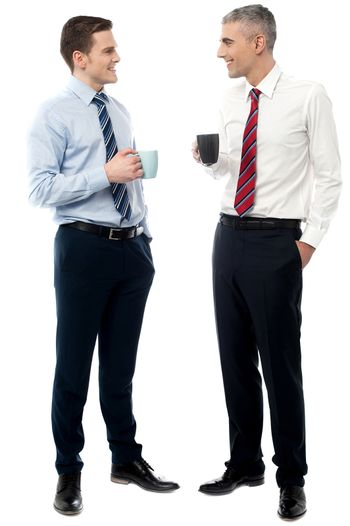 Handsome business executives toasting coffee