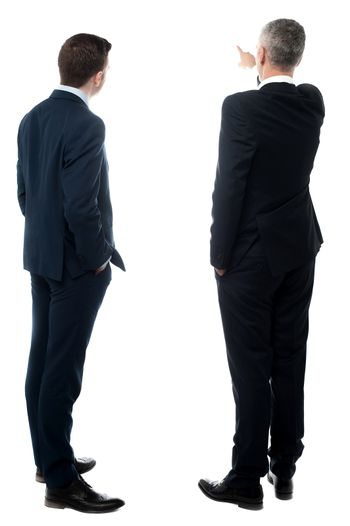 Rear-view image of two businessmen