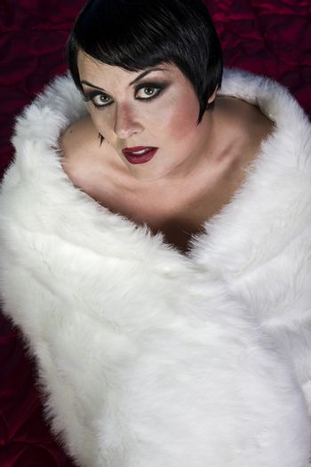 Make up, beautiful sexy brunette woman dressed in 20s style, hai