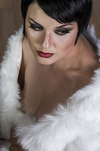 Flapper beautiful sexy brunette woman dressed in 20s style, hair