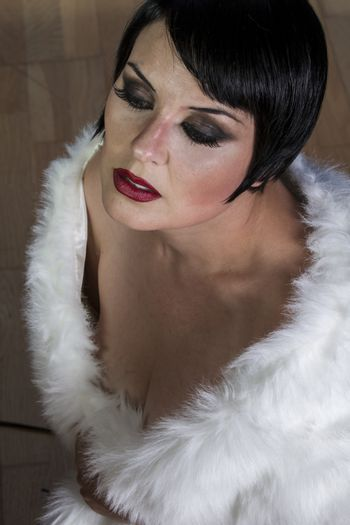 Single, beautiful sexy brunette woman dressed in 20s style, hair