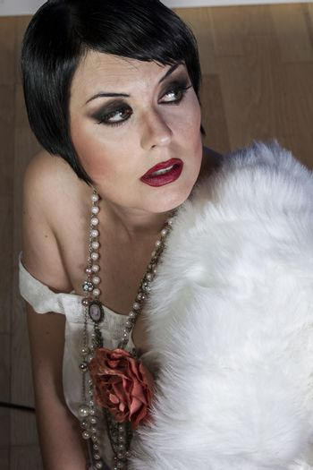 20s beautiful sexy brunette woman dressed in 20s style, hairstyl