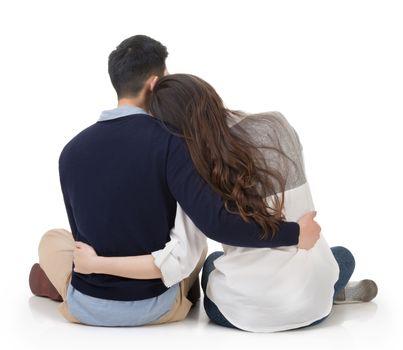Asian couple sit on ground