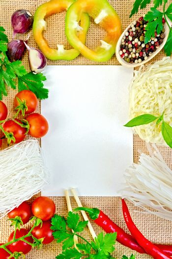 Frame of vegetables and funchozy with paper on sackcloth