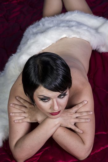 Nude beautiful sexy brunette woman dressed in 20s style, hairsty