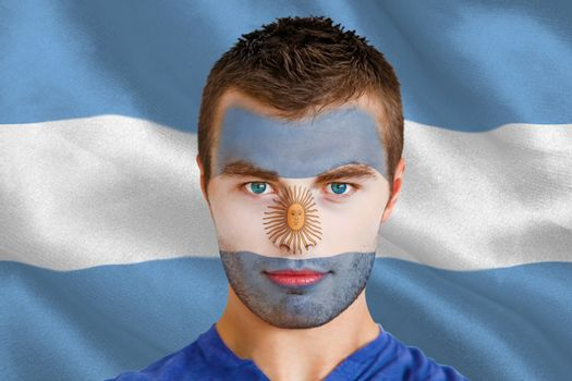 Serious young argentina fan with facepaint