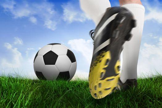Football boot kicking ball