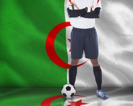 Goalkeeper in white with ball
